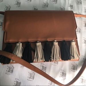 Lionel vegan leather tassel crossbody